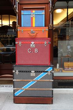 Monogrammed custom Goyard trunks.