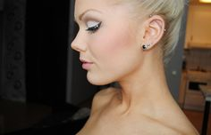 love the piercings and makeup.