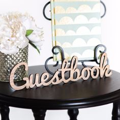 """Invite your guests to sign your guestbook with this rustic chic wooden sign at your wedding reception or other party! The word """"Guestbook"""" is precision cut in beautiful natural wood that can be used a"""