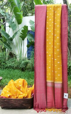 This marigold yellow Benares cotton has gold and silver zari bhuttas all over. The border is in magenta with gold and silver zari and a hint of green while the pallu is in pink with gold and silver...