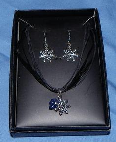 Hand-Made Boxed Set Tibetan Silver Snowflake Pendant & Earrings FREE SHIPPING. $12.00, via Etsy.