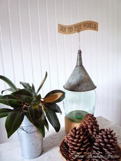 I had to pin this... the glass jug with the vintage tin funnel turned upside down with a little wire to hold the paper sign reminds me of the tin man in the Wizard of Oz :)