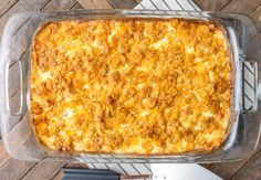 This is a staple at our summer grill-outs.  Its easy and can be prepared the day before, then baked when you need it.  I use reduced fat cheddar cheese, light sour cream and 98% fat-free cream of chicken soup.