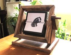 The animated wooden flipbook is perfect for weddings, engagements, birthdays, photographers, animators, or pretty much anyone looking for a unique gift. Bring your photos to life in sweet vintage style, just turn the handle and your animation spins into motion, all displayed beautifully in a wooden frame. Each flipbook contains 16 individual frames, and even the stain and border colours can be customized to your liking. We offer pre-made designs (DOG, SLINKY, NAPOLEON) as well as the CUSTOM…