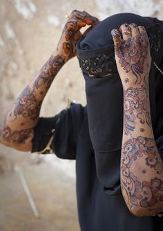 Africa | Henna painted arms of a young woman wearing a Hijab in Lamu, Kenya | © Eric Lafforgue