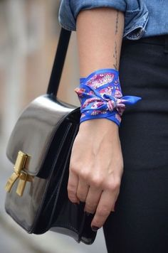 a pop of something unexpected, a silk handkerchief wrapped around your wrist.