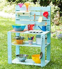 Make your backyard more fun with an inexpensive outdoor kitchen -- perfect for mud pies!