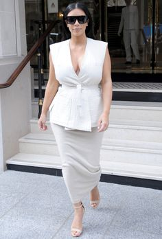 The expecting mother looked Parisian chic in a sleeveless Kimono top and pencil skirt accessorized with Manolo Blahnik heels and her favorite Celine sunglasses.