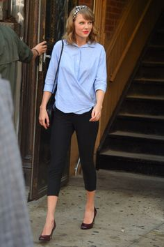 Who says leggings aren't pants? Taylor nodded to the 1950s by pairing her pedal pushers with a headband, red lipstick, and black heels.