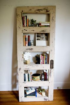 A vintage door now adds charm and display area to your room....Diy-Worn Out door shelf!