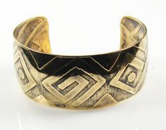 African design etched brass bracelet cuff.  Etched design, created by hand, is also on the inside of the bracelet. Cuff fits 6 inch wrist comfortably, but can be adjusted for smaller or slightly larger wrists.