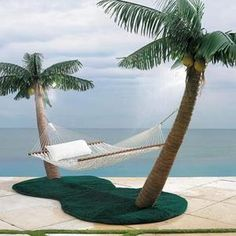 Palm Tree Hammock Stand with Cooling Mist Sprayers. Talk about paradise in your own backyard! This would be awesome.
