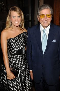 GRAMMY winners Carrie Underwood and Tony Bennett connect for a good cause at the Samsung Hope For Children Gala 2014 on June 10, 2014 in New York