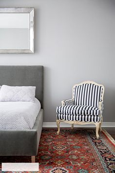 Striped upholstery and a vintage rug make for an eclectic mix | domino.com