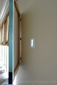 Hide that ugly thermostat,alarm, or other electronic gizmo Hide Thermostat, Thermostat Cover, Apartment Living, Apartment Ideas, Condo Living, Studio Apartment, Home Hacks, Home And Living, Living Room
