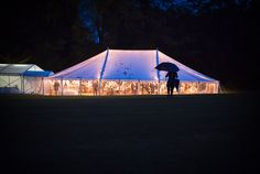 Glowing wedding marquee photograph. Photography by one thousand words wedding photographers www.onethousandwords.co.uk