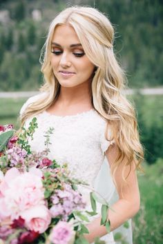 Gorgeous pink, green, red and purple bridal bouquet for an outdoor wedding in the mountains. Picture from the wedding we planned for Dancing With The Stars professional dancer, Lindsay Arnold