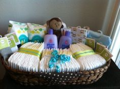 How To Make A Budget Baby Shower Basket. I think I'd like this more than a diaper cake! You can make a simple DIY Baby Shower Gift Basket on a tight budget. This thoughtful gift for new moms only LOOKS like an expensive gift. Baby Shower Gift Basket, Baby Baskets, Baby Boy Shower, Basket Gift, Baby Showers, Cheap Baby Shower Gifts, Practical Baby Shower Gifts, Diaper Shower, Raffle Baskets