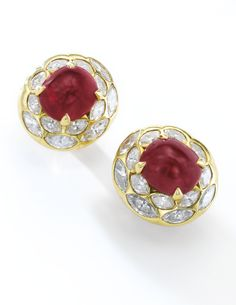 Pair of attractive ruby and diamond ear clips, Bulgari, 1980s Each set with a sugarloaf ruby weighing 14.48 and 14.79 carats respectively, and marquise-shaped diamonds, signed Bulgari.