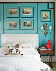 "In designer Kelee Katillac's master bedroom in Kansas City, Missouri, the mats on the Piranesi Grand Tour engravings and framed fabric behind the bed are the same silk blend as the curtains, Sophia, from Katillac's Couture Collection. The Greek key trim is custom-embroidered. ""Aquamarine symbolizes flow and harmony,"" Katillac says, ""while being vivid enough to be sexy."""