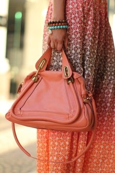 Great way to pair an ethnic look with a contemporary bag.  Great color!