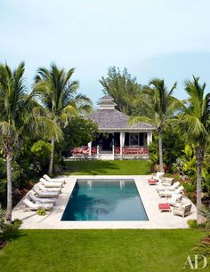 Alessandra Branca's Chic Bahamas Getaway | Architectural Digest: poolhouse with guest quarters...deck is outfitted with RH outdoor furniture
