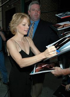 Jodie Foster signing silent auction items Charity Fundraising Packages by Charity Fundraising Packages www.charityfundra...