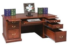 Amish Executive Desk with Raised Panel Back Dress your office to impress with an Amish made executive desk. Solid wood meets a custom build. Choose wood, stain and more. #desks