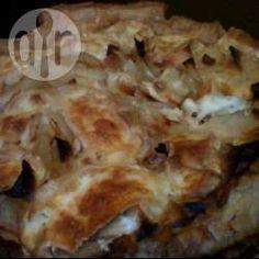 Foto recept: Hartige taart met ui en brie