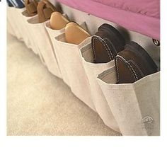 great shoe storage idea for a camper- cut a shoe organizer on strips to fit.