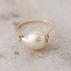 Display an iridescent baroque pearl on this simply elegant ring, hand-crafted by Brooklyn-based designer Mary MacGill.- White baroque pearl, gold fill hammered wire- Clean with warm water and soft cloth- Stone: Handmade in the USASize 7 Pearl Ring, Pearl Jewelry, Wire Jewelry, Jewelry Crafts, Antique Jewelry, Jewelry Rings, Jewelry Accessories, Jewelry Design, Pearl Earrings