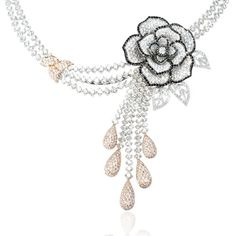 Fashion Bug Diamond 18k Two Tone Gold Flower Necklace, contains 1005 round brilliant cut white diamonds, of F color, VS2 clarity, of excellent cut and brilliance, weighing 32.02 carats total, 372 round brilliant cut pink diamonds, weighing 5.22 carats total with 248 round brilliant cut black diamonds, weighing 2.34 carats total. The diamond necklace measures approximately 17 inches in length and 55mm at the widest point of the center rose design.
