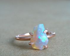 16 Opal Engagement Rings You'll Fall in Love With via Brit
