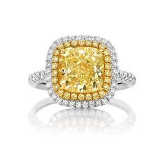 Featuring a magnificent 3.38ct Fancy Vivid Argyle Yellow Cushion Cut Diamond Halo Engagement ring hand made In 18ct Yellow Gold & Platinum with a double row of fancy vivid yellow & white diamond claw set. See more at http://www.armansfinejewellery.com/engagement-rings