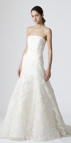 DEVON    Strapless modified mermaid gown with lily of the valley embroidery and criss cross grosgrain detail with back bows