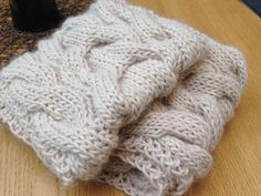 This super soft tube scarf with cables goes twice around the neck and is half lama, half wool.