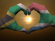 Gesture Made By Jamaica Flag Colored Hands Showing Symbol Of Heart And Love During Sunrise - Art Print
