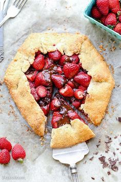 This rustic Chocolate Strawberry Galette will satisfy your sweet tooth guiltlessly! This simple Paleo dessert features fresh strawberries and dark chocolate chunks, folded into a flaky grain-free crust.