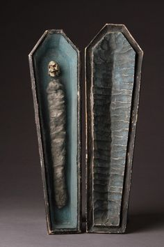 Dated 1761 Memento Mori of a carved wooden coffin, enclosing a skeleton in shroud, with ivory skull set behind glass. (Austria)