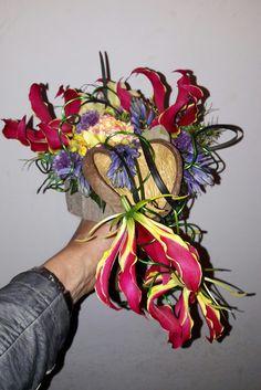 Exotisch bruidsboeketje gemaakt tijdens de bloemschikavond van groei en bloei Asten/Someren