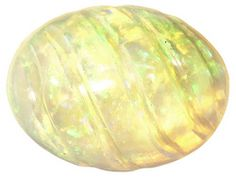 Ethiopian Opal Average .65ct 8x6mm Oval Carved Cabochon