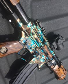 I'm not a huge fan of the wood furniture but man that looks good. http://www.czrifle.com