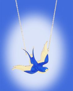 """Sparrow in Flight Necklace by Illegal Leopard - Illegal Leopard Jewelry brings us iconic imagery with vibrant colors and details like this large sparrow necklace in candy blue enamel with ivory details.  Pendant measures approx. 4"""" across making it a headturning statement piece."""