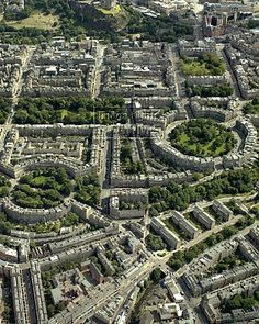 A wonderful view from the air of Edinburgh and it's famous Royal Circus and the other areas in New Town (built in the 18th c.) where terraced houses were built around around parks. Alex Maxwell's apartment is down there  on Circus Place...
