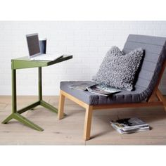 "tech on tap. laptop on tap. Clever laptopper tucks right in by sofa/chair to table/store laptop/iPad. Sleek angled profile retros prouve in slick hi-gloss camo green powdercoat. Smart iron sheet metal design piano-hinges open to store up to a 17"" laptop. Center cord management for neatniks."