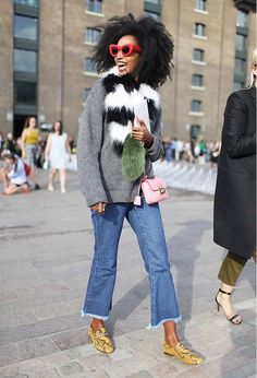 Fun fur scarf worn with denim kick flares, boyfriend sweater and statement red sunglasses. I love her.
