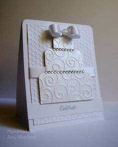 Emboss the paper for each layer of the cake, use the corner rounding punch, and adhere it all plus rhinestones!