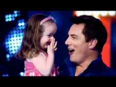 This little girl is my hero. I didn't know Barrowman could blush.