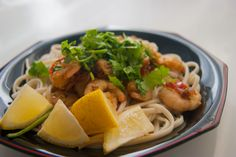 """Udon noodles with hot Thai prawns.  The lemon could perfectly be replaced by the kiddy lime (actually it would be much more """"Thai"""" than with lemon). However, everything goes very well, with that usual scent of the powerful Thai food, provided by the fish sauce, fresh coriander,chillies and ginger.  Caution: Hot."""