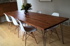 For the dining area, Wood Dining Tables with hairpin or flat iron legs.  I posted this photo to see show the look with pyramid eames replica chairs going for about $100 each.